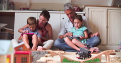 Parents And Children Playing With Digital Tablets In Bedroom Stock Footage