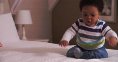 Cute Baby Having Fun Bouncing On Parents Bed Stock Footage