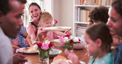 Group Of Families Having Meal At Home Together - stock footage