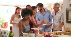 Group Of Friends Choosing Food From Party Buffet At Home Stock Footage