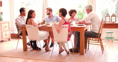 Group Of Friends Enjoying Dinner Party At Home Together Stock Footage