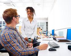 Business people young multi ethnic computer desk - stock photo