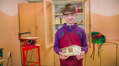 Kid proud about a wooden product in hand 4K Stock Footage
