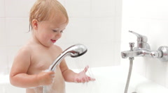 Young Girl Enjoying Bath Time Stock Footage