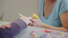 Female manicurist grinding customer nails 4K Stock Footage