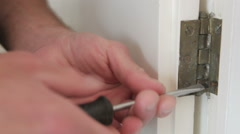 Close of Man Removing Screws From Hinge Stock Footage