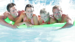 Group Of Friends On Holiday In Swimming Pool Stock Footage