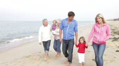 Multi Generation Family Walking Along Beach Together Stock Footage