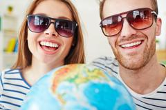 Smiling dates in sunglasses Stock Photos