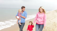Family Walking Along Beach Together Stock Footage