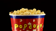 Popcorn in box on black, rotation Stock Footage