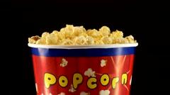 Popcorn in box on black, rotation Stock Footage