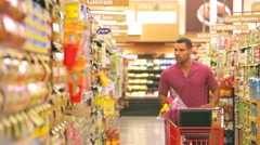 Stock Video Footage of Man Shopping In Supermarket