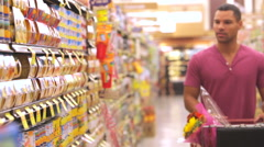 Man Shopping In Supermarket Stock Footage