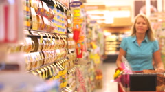 Woman Shopping In Supermarket Stock Footage