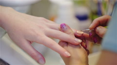 Stock Video Footage of Carefully applying gel to attractive fingernails 4K