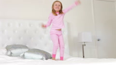 Young Girl Jumping On Bed Stock Footage