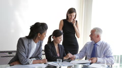 Group Of Businesspeople Having Meeting At Desk In Office Stock Footage