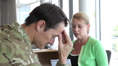 Soldier Talking To Female Counsellor In Office Stock Footage