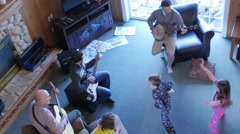 A family plays music and kids dance together at a party Stock Footage