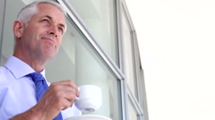 Businessman Standing Outside Office With Hot Drink Stock Footage