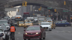 Traffic waiting at a traffic light under the Ed Koch Queensboro Bridge on 1st Stock Footage