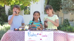 Children Holding Bake Sale Stock Footage