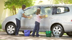 Two Girls Washing Car Together Stock Footage