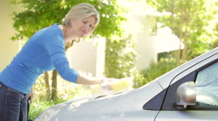 Woman Washing Car In Drive Stock Footage