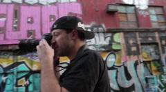 Photographer capturing Street Art Close-Up Stock Footage