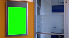 Green billboard for your ad on wall inside building Stock Footage