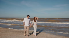 Young couple on the seaside Stock Footage
