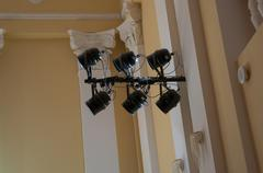 Equipment for stage lighting, hanging on the wall in the concert hall - stock photo