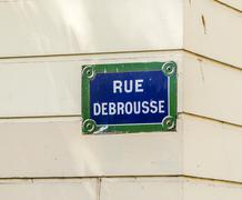 Paris, Rue Debrousse old street sign - stock photo