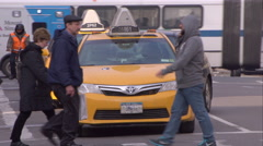 Two taxis waiting at a light on 2nd Avenue in Manhattan Stock Footage