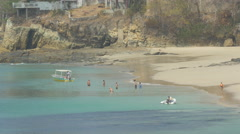 Group of tourists relaxing in the water on Contadora Island, Panama Stock Footage