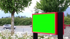 Green billboard for your ad with traffic flow background Stock Footage