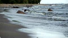 Storm waves rolled on the sandy shore of the sea. - stock footage