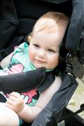 Cute White Blond Baby girl on Stroller - stock photo