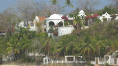 Villa surrounded by palm trees in Contadora Island, Panama Stock Footage