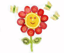 Creative fruit child dessert red flower and butterflies form Stock Photos