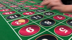 Casino: Gamblers Putting Chips On Numbers On Roulette Table Stock Footage