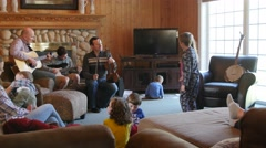 Family playing music and kids dance together at a party - stock footage