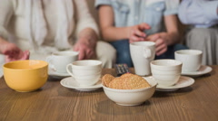 Tea cups and biscuits on table close up 4K Stock Footage