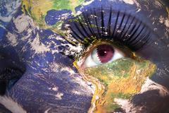 womans face with planet Earth texture and qatar flag inside the eye - stock photo