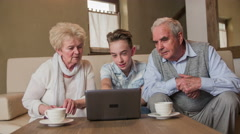 Grandparents looking on small laptop screen 4K Stock Footage