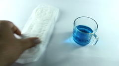 Testing sanitary pads for absorbency Stock Footage