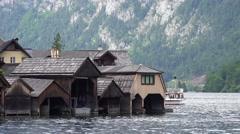 4k Boathouses close up on alps mountain lake in Hallstatt Stock Footage