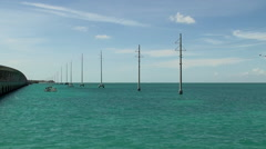 Power lines over water in the Florida Keys along Scenic Overseas Highway Stock Footage