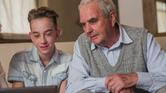 Boy educate elderly person about technology 4K Stock Footage